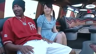 Petite Japanese girl has sex with Black guy in a limo