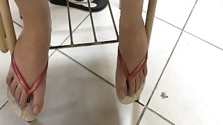 Candid college cute girl feet and toes in flip flops