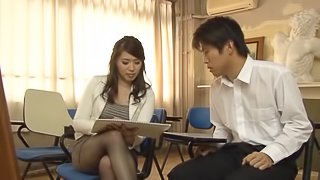 Mature Japanese babe in stockings and miniskirt with long hair giving a steamy blowjob