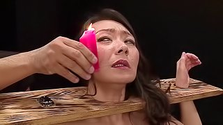 Japanese woman covered in wax during a kinky BDSM game