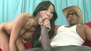 Asian with fake tits takes big black cock