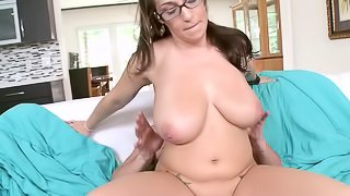 Nerdy glasses girl with huge natural tits fucked by a big dick