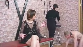 Poor guy is tied up and spanked by a pair of naughty mistresses